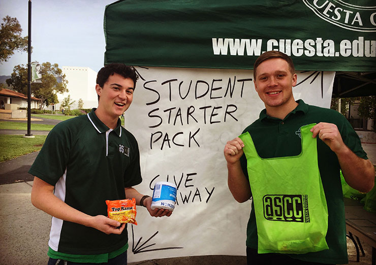 ASCC officers giving out survival kits