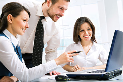 Professional Man and women discussing business in front of a computer.